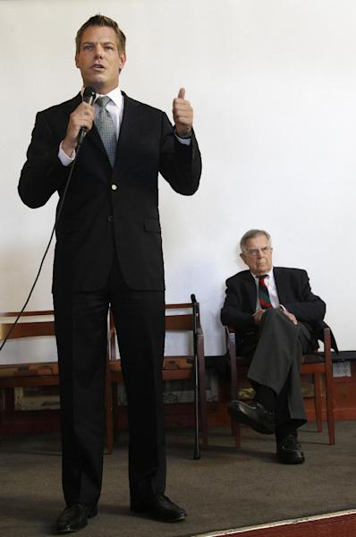 In this photo taken Sept. 7, 2012, California Rep. candidate Eric Swalwell speaks at left as Rep. Pete Stark, D-Calif. listens during an Alameda County Democratic Lawyers Club endorsement meeting at Everett & Jones Barbeque in Oakland, Calif. Stark is used to coasting to re-election in the liberal enclave of the San Francisco Bay area he has represented since the end of the Vietnam War. Legislative gerrymandering kept him in a heavily Democratic district, and California's primary system virtually ensured that he would emerge to face Republican or fringe-party challengers with almost no chance of beating him in November. All that has changed this year, as Californians deal with two major political reforms that are remaking the congressional landscape and creating competitive races for the first time in many years. (AP Photo/Jeff Chiu)