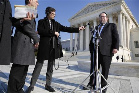 Rabbi Binyomin Ginsberg (R) talks to reporters about his case, in which he sued Northwest Airlines for breach of contract after the airline said he had abused their frequent flyer program, following arguments before the U.S. Supreme Court in Washington December 3, 2013. REUTERS/Jonathan Ernst