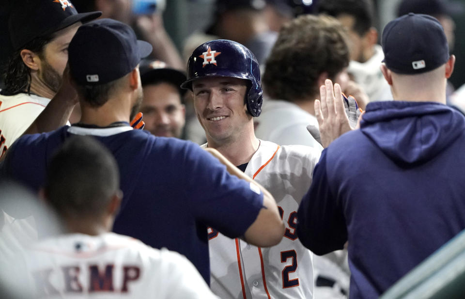 Houston Astros' Alex Bregman (2) is congratulated in the dugout after hitting a home run against the Chicago White Sox during the fourth inning of a baseball game Wednesday, May 22, 2019, in Houston. (AP Photo/David J. Phillip)