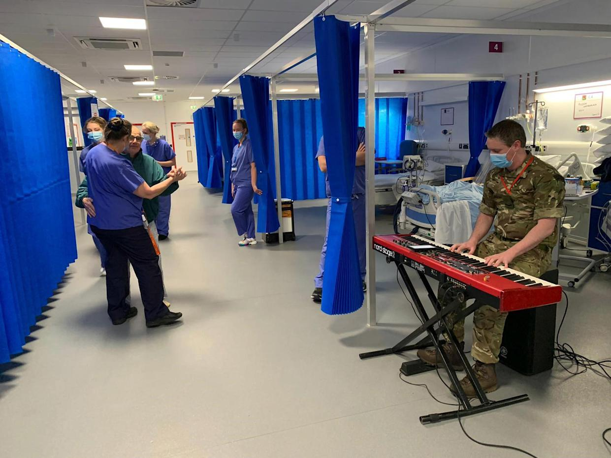 Dancing on the ward at Exeter to music provided by the Royal Marines Band (Royal Navy/PA)