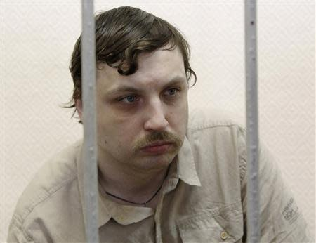 Kosenko sits inside defendants' cage during a court hearing in Moscow