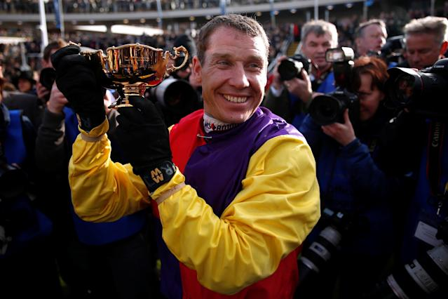 Horse Racing - Cheltenham Festival - Cheltenham Racecourse, Cheltenham, Britain - March 16, 2018 Richard Johnson celebrates with the trophy after riding Native River to victory in the 15.30 Timico Cheltenham Gold Cup Chase Action Images via Reuters/Matthew Childs