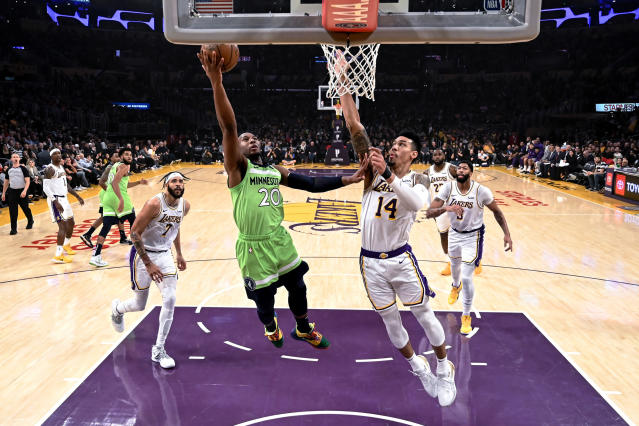 Minnesota Timberwolves' Josh Okogie (20) goes to basket under pressure from Los Angeles Lakers' Danny Green (14) during the first half of an NBA basketball game, Sunday, Dec. 8, 2019, in Los Angeles. (AP Photo/Ringo H.W. Chiu)