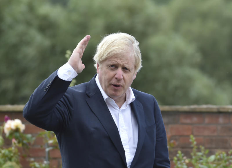 Britain's Prime Minister Boris Johnson speaks to local people at the Canal Side Heritage Centre in Beeston near Nottingham, England, Tuesday, July 28, 2020. The government is launching a new cycling intuitive to help get people fitter. (AP Photo/Rui Vieira, Pool)
