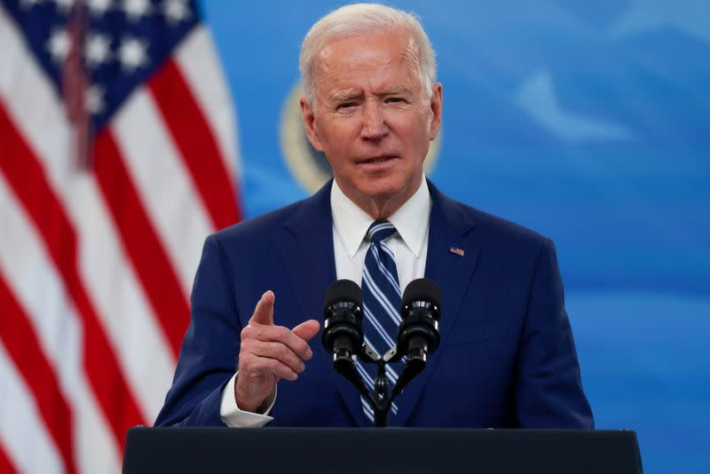 FILE PHOTO: U.S. President Biden delivers remarks after a meeting with his COVID-19 Response Team at the White House campus in Washington