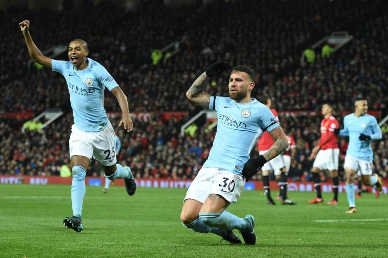 Manchester City defender Nicolas Otamendi (R) celebrates scoring against Manchester United during a game at Old Trafford in Manchester, north west England, on December 10, 2017
