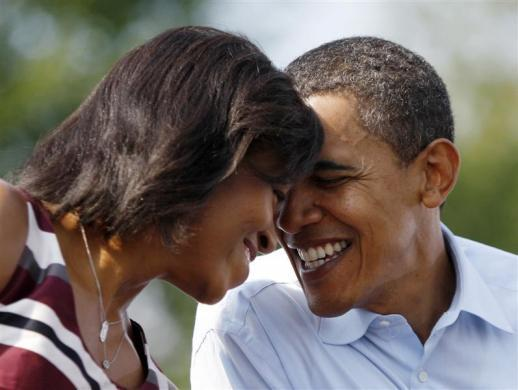 Barack Obama shares a moment with his wife Michelle on stage at a campaign rally outside the Detroit Public Library September 28, 2008.