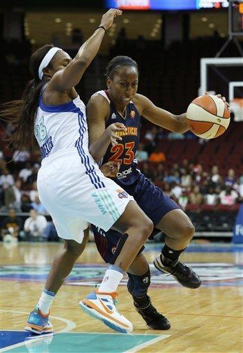 Connecticut Sun guard Allison Hightower, right, battles against New York Liberty guard Cappie Pondexter, left, during a WNBA basketball game at the Prudential Center, Thursday, Aug.16, 2012, in Newark, N.J. (AP Photo/John Minchillo)
