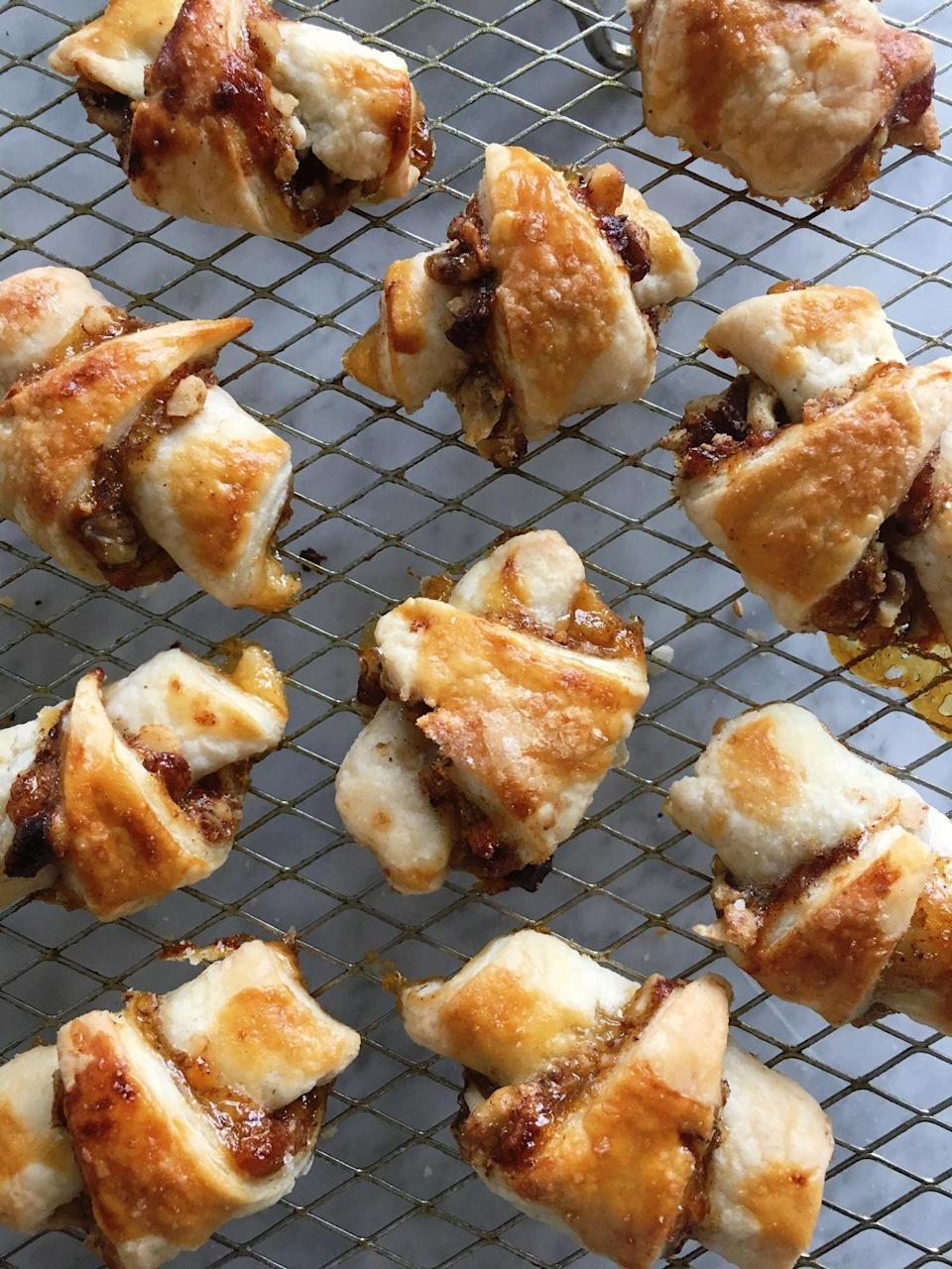 """<p>It's not a proper celebration of the festival of lights without a batch of rugelach. This classic Jewish cookie which is typically served during Hanukkah is an absolute must when it comes to holiday baking. Made with a super straightforward, 4-ingredient dough in the food processor, this pastry is far from intimidating. In this variation, we used our favorite apricot jam along with some hearty walnuts for the perfect fruit and nut dessert. If you don't have apricots or walnuts, any fruit and nut combination will do.</p> <p><a href=""""https://www.myrecipes.com/recipe/apricot-walnut-rugelach"""" rel=""""nofollow noopener"""" target=""""_blank"""" data-ylk=""""slk:Apricot and Walnut Rugelach Recipe"""" class=""""link rapid-noclick-resp"""">Apricot and Walnut Rugelach Recipe</a></p>"""