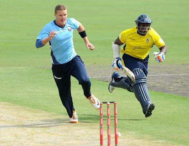 PRETORIA, SOUTH AFRICA - OCTOBER 10:  Michael Carberry of Hampshire runs to make his ground during the Karbonn Smart CLT20 Champions League Twenty20 pre-tournament Qualifying Stage match between Hampshire Royals (England) and Auckland Aces (New Zealand) at SuperSport Park on October 10, 2012 in Pretoria, South Africa. (Photo by Lee Warren / Gallo Images/Getty Images)