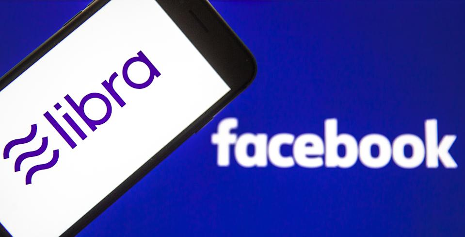 ANKARA, TURKEY - FEBRUARY 27: In this photo illustration a smart phone displays the logo of Libra and a computer screen displays the Facebook logo in Ankara Turkey on February 27, 2020. Ali Balikci / Anadolu Agency