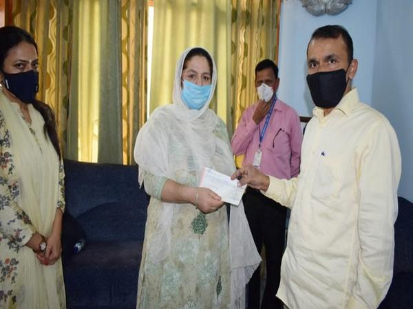 PS to Jammu and Kashmir Lieutenant Governor Nitishwar Kumar handed cheque to family of slain BDC (Picture credits: DIPR J-K Twitter)