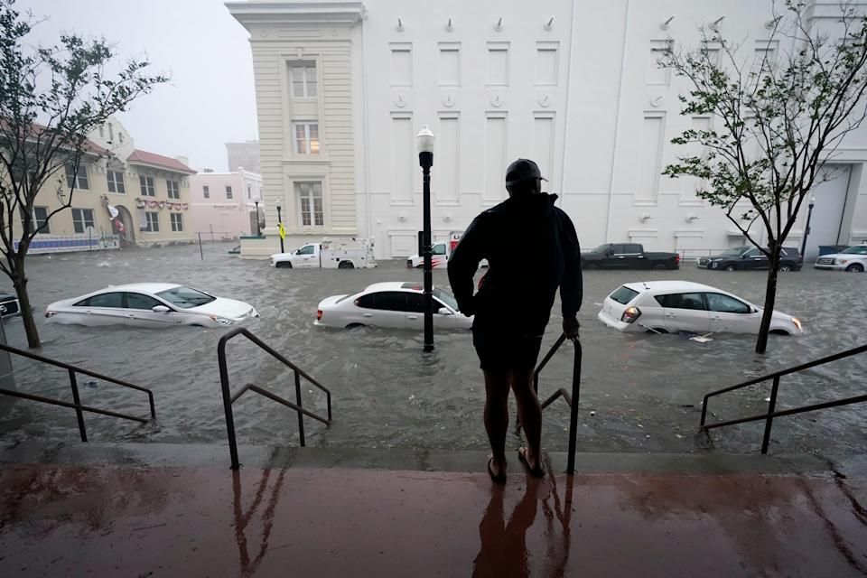 Flood waters move on the street, Wednesday, Sept. 16, 2020, in downtown Pensacola, Fla.
