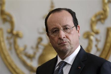 French President Francois Hollande attends a new year ceremony with members of the government at the Elysee Palace in Paris