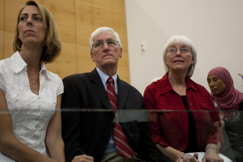 Cindy, right, and Craig Corrie, center, the parents of Rachel Corrie, a pro-Palestinian activist who was killed by an Israeli bulldozer in Gaza in 2003, sit together with their daughter Sarah in the court room just before the district court's ruling in Haifa, Israel, Tuesday, Aug. 28, 2012. An Israeli court on Monday rejected a lawsuit brought against the military by the parents of a U.S. activist crushed to death by an army bulldozer during a 2003 demonstration, ruling the army was not at fault for her death. The bulldozer driver has said he didn't see 23-year-old Rachel Corrie, who was trying to block the vehicle's path during a demonstration in the Gaza Strip against the military's demolition of Palestinian homes. The military deemed her March 2003 death to be accidental, but Corrie's parents were not satisfied by the army investigation and filed a civil lawsuit two years later. (AP Photo/Ariel Schalit)