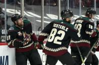 Arizona Coyotes right wing Phil Kessel (81) celebrates his goal against the San Jose Sharks with defenseman Jordan Oesterle (82) and center Christian Dvorak (18) during the third period of an NHL hockey game Thursday, Jan. 14, 2021, in Glendale, Ariz. (AP Photo/Ross D. Franklin)