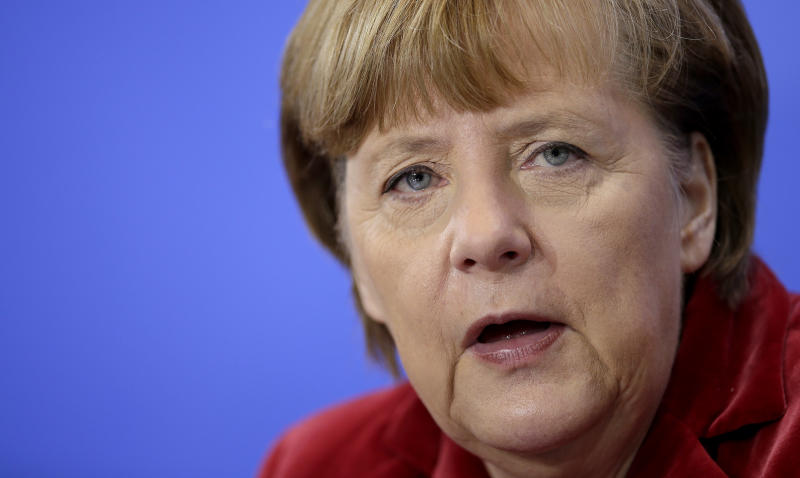 German Chancellor Angela Merkel addresses the media during a joint press conference with the President of Poland, Donald Tusk, after a meeting at the chancellery in Berlin, Germany, Friday, Jan. 31, 2014. (AP Photo/Michael Sohn)