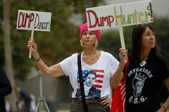 Protesters gather as Rep. Duncan Hunter, R-Calif., makes an appearance at federal court in San Diego on Sept. 24, 2018. (Photo: Mike Blake/Reuters)