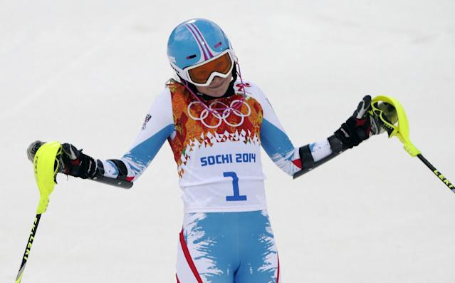 Austria's Bernadette Schild reacts after finishing he first run of the women's slalom at the Sochi 2014 Winter Olympics, Friday, Feb. 21, 2014, in Krasnaya Polyana, Russia.(AP Photo/Gero Breloer)