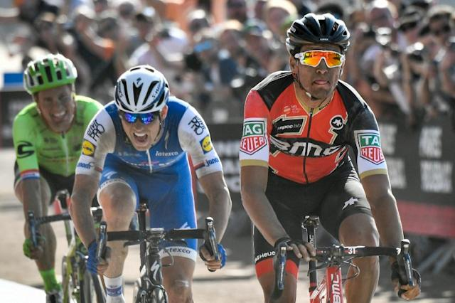 (From R) Belgium's Greg Van Avermaet, Czech Republic's Zdenek Stybar and Netherlands' Sebastian Langeveld ride towards the finish line at the end of the 115th edition of the Paris-Roubaix one-day classic cycling race, on April 9, 2017 (AFP Photo/PHILIPPE LOPEZ)
