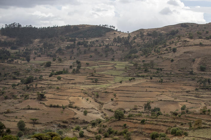 Terraced hills are seen off the road between Gondar and Danshe, a town in an area of western Tigray annexed by the Amhara region during the ongoing conflict, in Ethiopia Saturday, May 1, 2021. Ethiopia faces a growing crisis of ethnic nationalism that some fear could tear Africa's second most populous country apart, six months after the government launched a military operation in the Tigray region to capture its fugitive leaders. (AP Photo/Ben Curtis)
