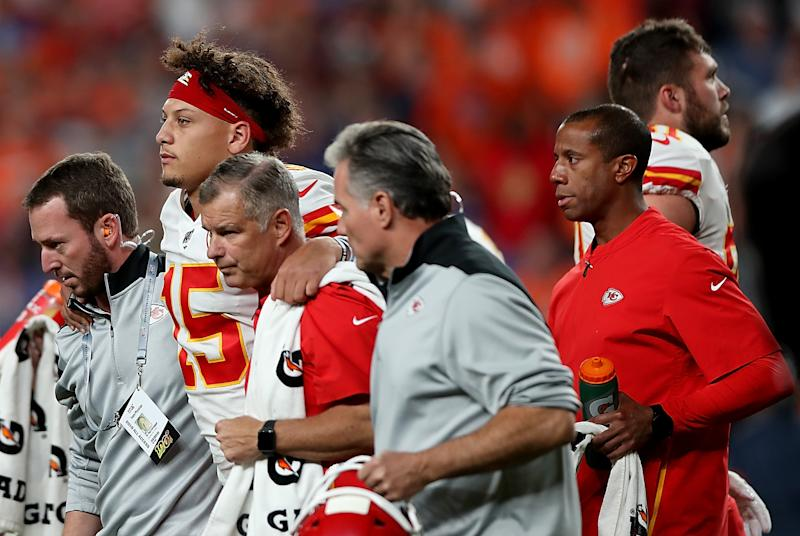 DENVER, COLORADO - OCTOBER 17: Quarterback Patrick Mahomes #15 of the Kansas City Chiefs is escorted off the field after an injury on the first half against the Denver Broncos in the game at Broncos Stadium at Mile High on October 17, 2019 in Denver, Colorado. (Photo by Matthew Stockman/Getty Images)