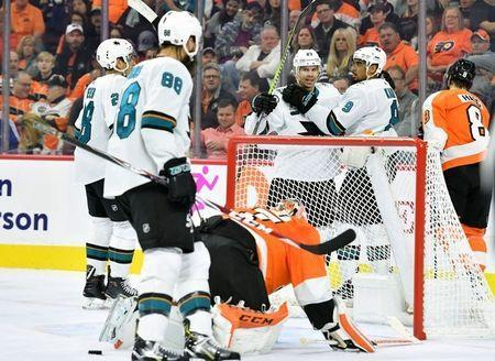 Oct 9, 2018; Philadelphia, PA, USA; San Jose Sharks left wing Evander Kane (9) celebrates with right wing Joonas Donskoi (27) after scoring a goal past Philadelphia Flyers goaltender Brian Elliott (37) during the first period at Wells Fargo Center. Mandatory Credit: Eric Hartline-USA TODAY Sports