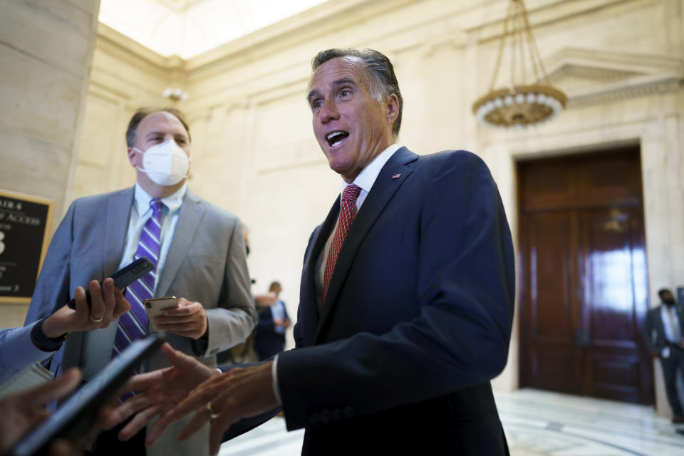"""Sen. Mitt Romney, R-Utah, talks briefly to reporters after attending a bipartisan barbecue luncheon, at the Capitol in Washington, Thursday, Sept. 23, 2021. Senate Majority Leader Chuck Schumer and House Speaker Nancy Pelosi say they and the White House have agreed to a """"framework"""" to pay for their emerging $3.5 trillion social and environment bill. (AP Photo/J. Scott Applewhite)"""