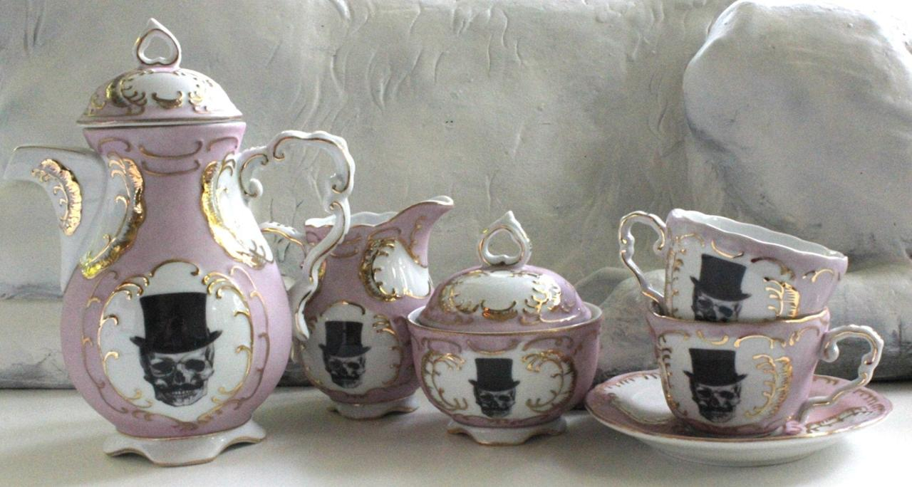 """<p>Host a spooky tea party with these <a href=""""https://www.popsugar.com/buy/Pink-amp-Gold-Sugarskull-Skull-Top-Hat-Tea-Cups-491561?p_name=Pink%20%26amp%3B%20Gold%20Sugarskull%20Skull%20Top%20Hat%20Tea%20Cups&retailer=etsy.com&pid=491561&price=27&evar1=casa%3Aus&evar9=46628527&evar98=https%3A%2F%2Fwww.popsugar.com%2Fhome%2Fphoto-gallery%2F46628527%2Fimage%2F46628558%2FPink-Gold-Sugarskull-Skull-Top-Hat-Tea-Cups&list1=halloween%2Challoween%20decor&prop13=api&pdata=1"""" rel=""""nofollow"""" data-shoppable-link=""""1"""" target=""""_blank"""" class=""""ga-track"""" data-ga-category=""""Related"""" data-ga-label=""""http://www.etsy.com/listing/293254699/pink-gold-sugarskull-skull-top-hat-tea"""" data-ga-action=""""In-Line Links"""">Pink &amp; Gold Sugarskull Skull Top Hat Tea Cups</a> ($27-$32). For the whole experience, get the <a href=""""https://www.popsugar.com/buy/Pink-amp-Gold-Sugarskull-Skull-Top-Hat-Tea-Cups-491561?p_name=Pink%20%26amp%3B%20Gold%20Sugarskull%20Skull%20Top%20Hat%20Tea%20Cups&retailer=etsy.com&pid=491561&price=27&evar1=casa%3Aus&evar9=46628527&evar98=https%3A%2F%2Fwww.popsugar.com%2Fhome%2Fphoto-gallery%2F46628527%2Fimage%2F46628558%2FPink-Gold-Sugarskull-Skull-Top-Hat-Tea-Cups&list1=halloween%2Challoween%20decor&prop13=api&pdata=1"""" rel=""""nofollow"""" data-shoppable-link=""""1"""" target=""""_blank"""" class=""""ga-track"""" data-ga-category=""""Related"""" data-ga-label=""""http://www.etsy.com/listing/293254699/pink-gold-sugarskull-skull-top-hat-tea"""" data-ga-action=""""In-Line Links"""">entire tea set</a> ($145-$155)! </p>"""
