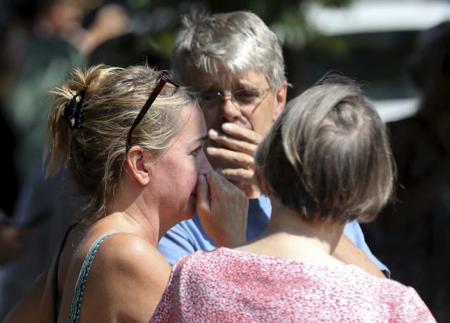 <p>Former Minnehaha Academy employees Elizabeth Van Pilsum, left, and Rick Olson, center, react after an explosion at the school Aug. 2, 2017, in Minneapolis. (David Joles/Star Tribune via AP) </p>