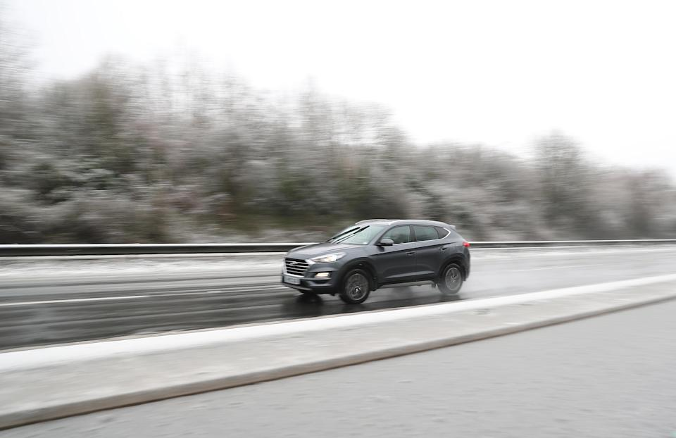 A car in snowy conditions on the A303 near Andover. (Photo by Andrew Matthews/PA Images via Getty Images)