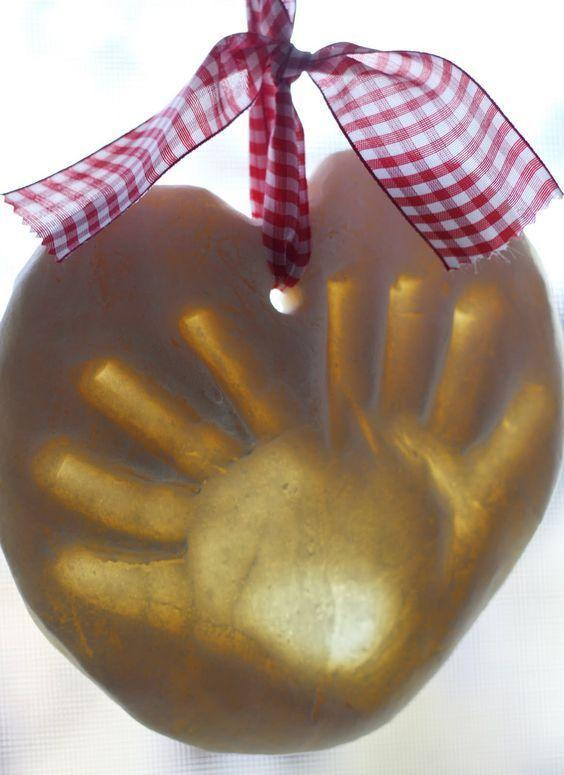 """<p>Immortalize your kid's handprint in salt dough with this easy ornament project even the littlest kids will enjoy having a (ahem) hand in. Hang them from the tree or mantle with pretty ribbon.</p><p><em><a href=""""https://www.nestofposies-blog.com/2011/11/salt-dough-handprint-ornaments/"""" rel=""""nofollow noopener"""" target=""""_blank"""" data-ylk=""""slk:Get the tutorial at Nest of Posies"""" class=""""link rapid-noclick-resp"""">Get the tutorial at Nest of Posies</a></em><br></p><p><strong>RELATED</strong>: <a href=""""https://www.goodhousekeeping.com/holidays/christmas-ideas/g29565759/best-salt-dough-ornaments/"""" rel=""""nofollow noopener"""" target=""""_blank"""" data-ylk=""""slk:15 Best Salt Dough Ornaments to DIY This Holiday Season"""" class=""""link rapid-noclick-resp"""">15 Best Salt Dough Ornaments to DIY This Holiday Season</a><br></p>"""