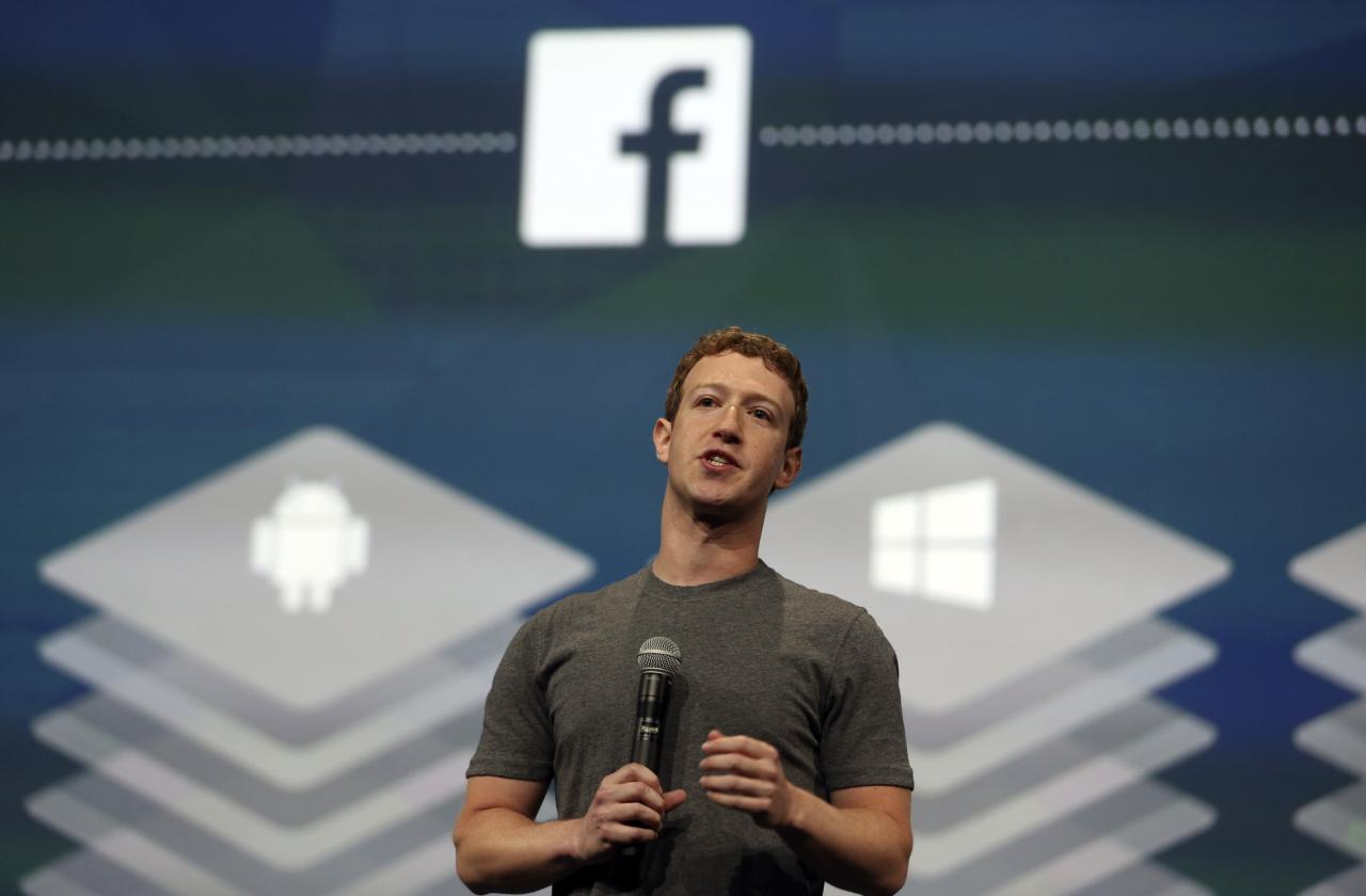 Facebook CEO Mark Zuckerberg speaks during his keynote address at Facebook's f8 developers conference in San Francisco, California in this April 30, 2014, file photo. Facebook Inc's FB.O revenue rose 59 percent in the third quarter as the social networking service saw strong demand for its mobile ads, October 28, 2014. REUTERS/Robert Galbraith/Files (UNITED STATES - Tags: BUSINESS)
