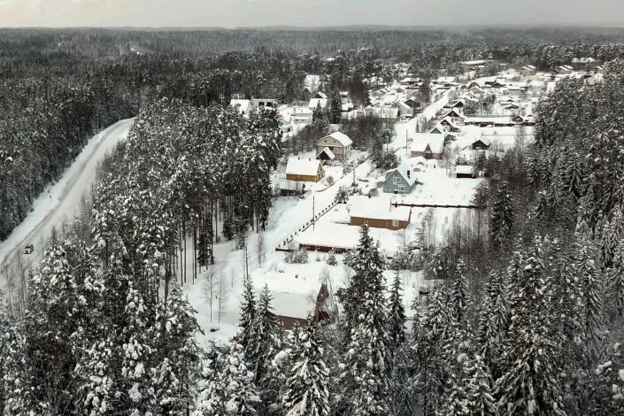 Snow coats the village of Ikhala in Russia's Karelia region, Tuesday, Feb. 16, 2021. Russia's rollout of its coronavirus vaccine is only now picking up speed in some of its more remote regions, although experts say the campaign is still moving slowly. (AP Photo/Kirill Zarubin)