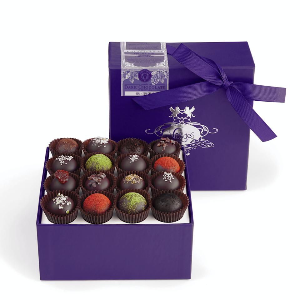 """<p><strong>Vosges Haut-Chocolat</strong></p><p>goldbelly.com</p><p><strong>$49.00</strong></p><p><a href=""""https://go.redirectingat.com?id=74968X1596630&url=https%3A%2F%2Fwww.goldbelly.com%2Fvosges%2Fdark-chocolate-truffle-collection-16-pieces&sref=https%3A%2F%2Fwww.redbookmag.com%2Ffood-recipes%2Fg35014712%2Fbest-boxed-chocolates%2F"""" rel=""""nofollow noopener"""" target=""""_blank"""" data-ylk=""""slk:Shop Now"""" class=""""link rapid-noclick-resp"""">Shop Now</a></p><p>Vosges has made a name for themselves with their decadent, uniquely flavored truffles. From chile, to absinthe, to wasabi, to Balsamic vinegar, this collection of dark chocolate treats will take your tastebuds on an adventure. </p>"""