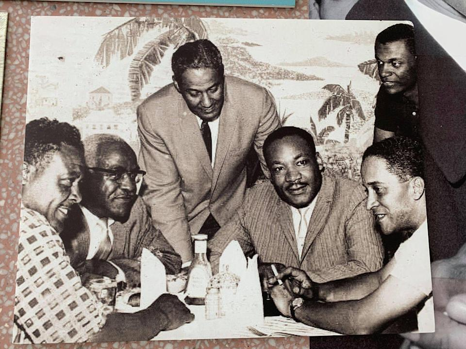 Dr. Martin Luther King Jr. dines at the Hampton House cafe in the early 1960s.