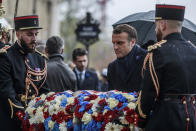 French President Emmanuel Macron lays a wreath in front of the statue of Georges Clemenceau in Paris, Monday Nov., 11 2019, as part of the commemorations marking the 101st anniversary of the armistice, ending World War I. (Christophe Petit Tesson,/Pool via AP)