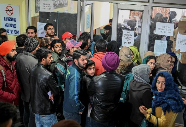 Kashmiri students wait for their turn to use the internet, with only around a dozen kiosks for the region's seven million inhabitants