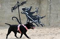 Recent works attributed to Banksy appeared on a wall at North Beach in Lowestoft on the east coast of England, in August (AFP/JUSTIN TALLIS)