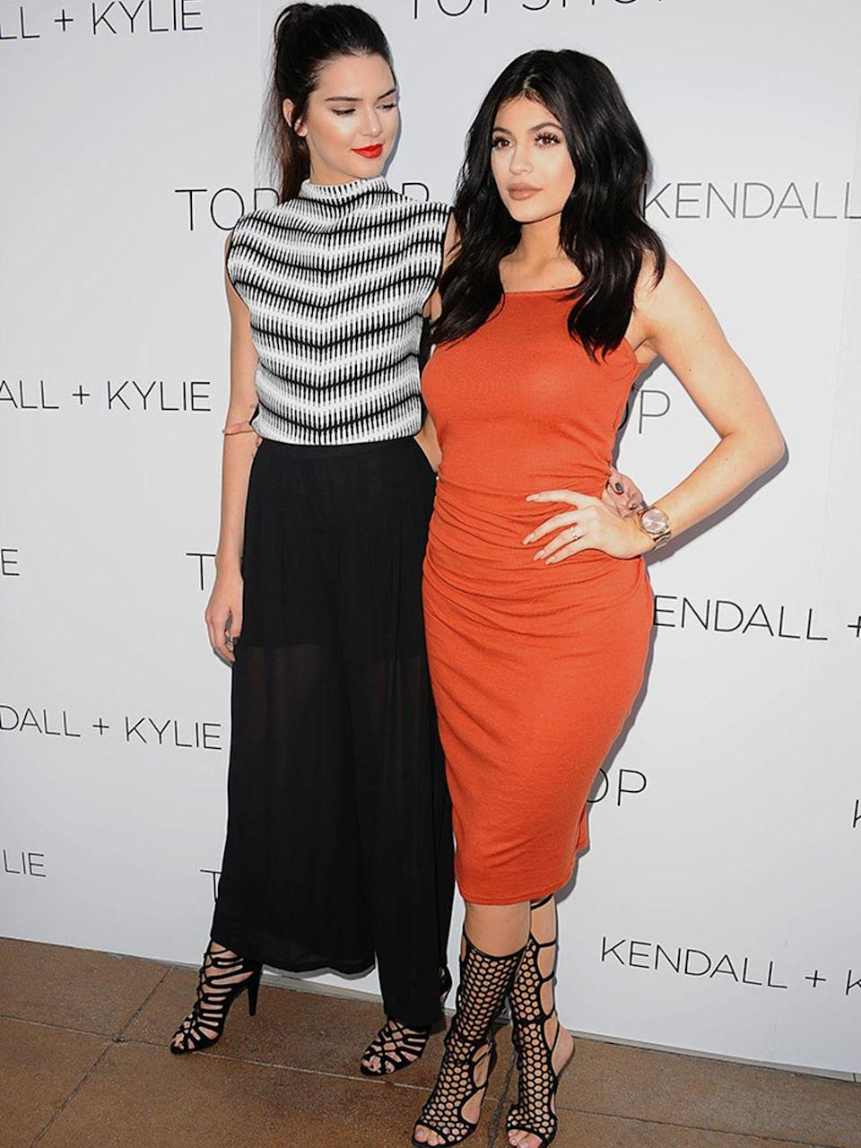 <p>Kendall and Kylie Jenner at the Kendal + Kylie Topshop launch in Los Angeles, June 2015.</p>