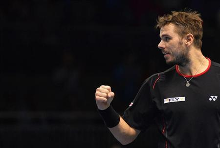 Stanislas Wawrinka of Switzerland reacts during his ATP World Tour Finals tennis men's singles match victory over Tomas Berdych of the Czech Republic at the O2 Arena in London