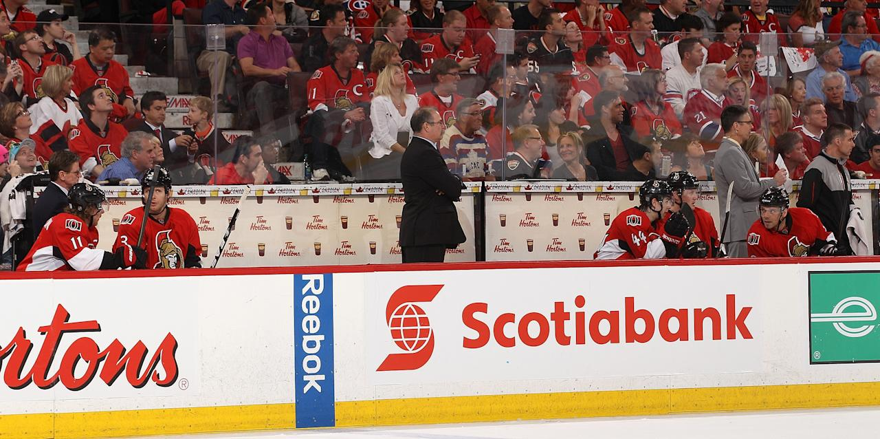 OTTAWA, CANADA - MAY 5: Head coach Paul MacLean of the Ottawa Senators stands on the bench and watches the play as his choice of players dwindled to Daniel Alfredsson #11, Marc Methot #3; Jean-Gabriel Pageau #44, Erik Condra #22 and Milan Michalek #9 due to penalties and injuries in the third period against the Montreal Canadiens in Game Three of the Eastern Conference Quarterfinals during the 2013 NHL Stanley Cup Playoffs at Scotiabank Place, on May 5, 2013 in Ottawa, Ontario, Canada.  (Photo by Jana Chytilova/Freestyle Photography/Getty Images)