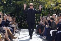 Michael Kors acknowledges audience applause after his Spring/Summer 2022 collection was modeled during Fashion Week in New York, Friday, Sept. 10, 2021. (AP Photo/Richard Drew)