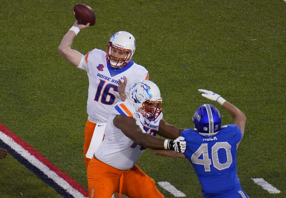 Boise State quarterback Jack Sears throws a pass as offensive lineman John Ojukwu, front left, blocks Air Force linebacker Alec Mock during the second half of an NCAA college football game Saturday, Oct. 31, 2020, at Air Force Academy, Colo. (AP Photo/David Zalubowski)