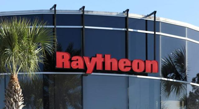 Raytheon (RTX) defense company logo hanging from glass building