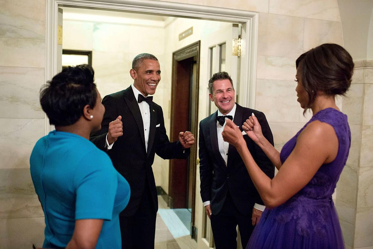 Barack Obama and Michelle Obama celebrate with outgoing social secretary Jeremy Bernard and incoming social secretary Deesha Dyer after a statedinner at the White House on April 28, 2015.