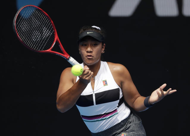 Australia's Destanee Aiava hits a forehand return to United States' Madison Keys during their first round match at the Australian Open tennis championships in Melbourne, Australia, Tuesday, Jan. 15, 2019. (AP Photo/Kin Cheung)