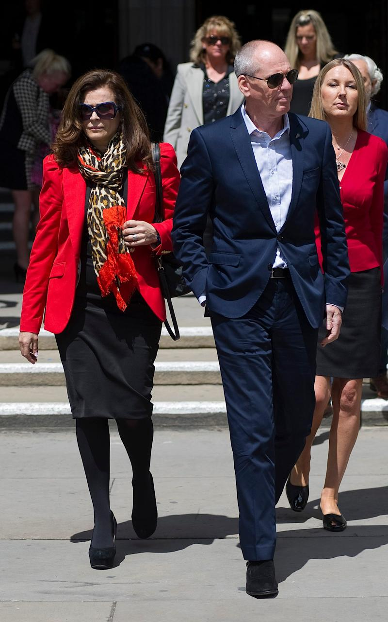 Crime boss Terry Adams leaves the High Court at lunchtime today with his wife Ruth