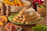 "<p>Tamales are a traditional Mexican dish made from corn dough stuffed with meat, cheese, and anything else you could possibly want, and then wrapped in a banana leaf or corn husk. Though tamales are eaten year-round and most special occasions, they take on a special meaning during the holiday season. CNN reported that <a href=""https://www.cnn.com/travel/article/new-years-food-traditions/index.html"" rel=""nofollow noopener"" target=""_blank"" data-ylk=""slk:families gather together to make tamales"" class=""link rapid-noclick-resp"">families gather together to make tamales</a>, assigning one aspect of the cooking process to each individual person. On New Year's tamales are served with menudo, a tripe and hominy soup. <strong><br></strong></p><p><strong>Recipes: </strong></p><p><em><a href=""https://www.womansday.com/food-recipes/food-drinks/recipes/a9958/tamale-pies-121438/"" rel=""nofollow noopener"" target=""_blank"" data-ylk=""slk:Tamale Pies"" class=""link rapid-noclick-resp"">Tamale Pies</a></em></p><p><em><a href=""https://www.womansday.com/food-recipes/food-drinks/a21054089/strawberry-tamales-recipe/"" rel=""nofollow noopener"" target=""_blank"" data-ylk=""slk:Strawberry Tamales"" class=""link rapid-noclick-resp"">Strawberry Tamales</a></em><br></p><p><em><a href=""https://www.womansday.com/food-recipes/food-drinks/recipes/a16596/pork-tamale-pie-2907/"" rel=""nofollow noopener"" target=""_blank"" data-ylk=""slk:Pork Tamale Pie"" class=""link rapid-noclick-resp"">Pork Tamale Pie</a></em></p><p><em><em><a href=""https://www.womansday.com/food-recipes/food-drinks/recipes/a13689/corn-black-bean-tamales-3642/"" rel=""nofollow noopener"" target=""_blank"" data-ylk=""slk:Corn and Black Bean Tamales"" class=""link rapid-noclick-resp"">Corn and Black Bean Tamales</a></em><br></em></p><p><em><a href=""https://www.womansday.com/food-recipes/food-drinks/recipes/a13377/no-bake-tamale-pie/"" rel=""nofollow noopener"" target=""_blank"" data-ylk=""slk:No-Bake Tamale Pie"" class=""link rapid-noclick-resp"">No-Bake Tamale Pie</a><br></em></p>"