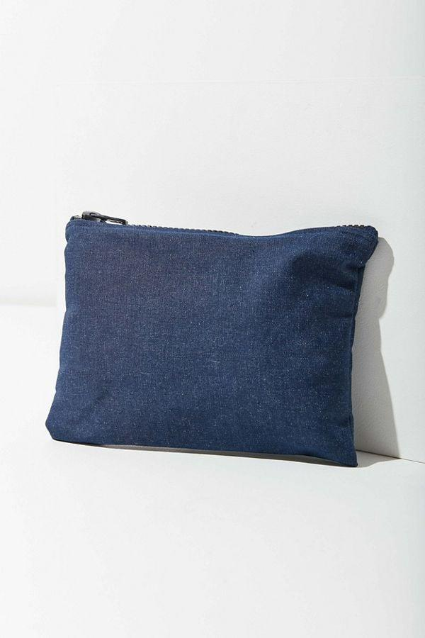 """<p>If you're looking for something low-key, get this <a href=""""https://www.popsugar.com/buy/Urban-Renewal-Recycled-Denim-Pouch-477772?p_name=Urban%20Renewal%20Recycled%20Denim%20Pouch&retailer=urbanoutfitters.com&pid=477772&price=10&evar1=savvy%3Auk&evar9=46479463&evar98=https%3A%2F%2Fwww.popsugar.com%2Fsmart-living%2Fphoto-gallery%2F46479463%2Fimage%2F46479467%2FUrban-Renewal-Recycled-Denim-Pouch&list1=shopping%2Ctravel%2Cbags%2Ctraveling%2Corganization%2Ctravel%20tips&prop13=api&pdata=1"""" rel=""""nofollow"""" data-shoppable-link=""""1"""" target=""""_blank"""" class=""""ga-track"""" data-ga-category=""""Related"""" data-ga-label=""""https://www.urbanoutfitters.com/shop/urban-renewal-recycled-denim-pouch?category=SEARCHRESULTS&amp;color=091"""" data-ga-action=""""In-Line Links"""">Urban Renewal Recycled Denim Pouch</a> ($10, originally $19).</p>"""